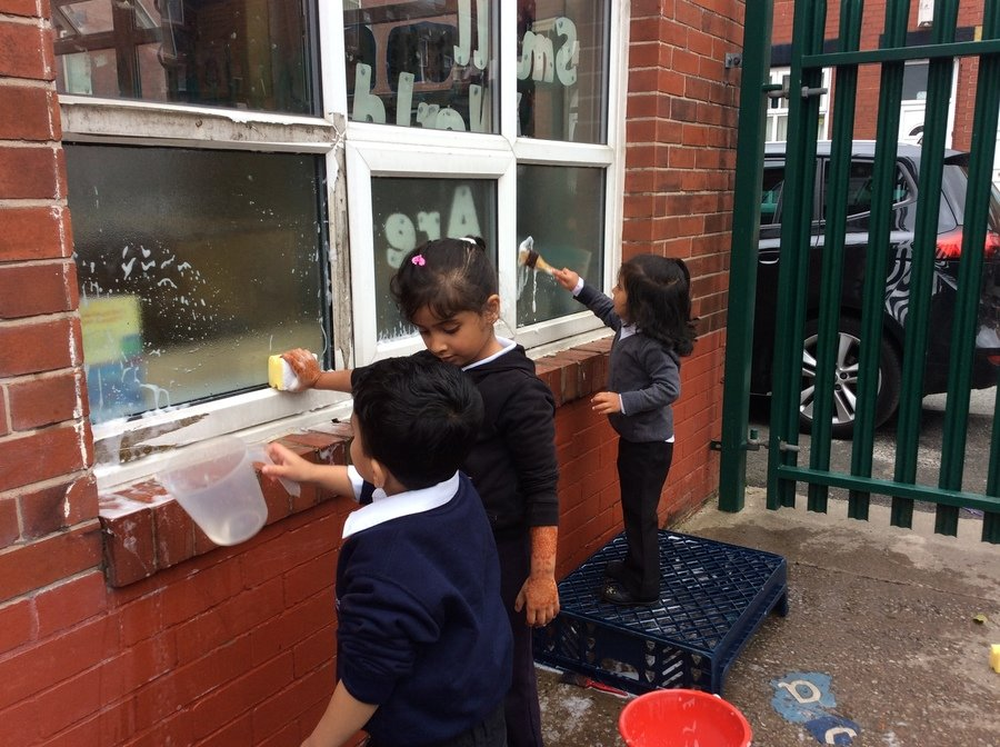 We have been learning about jobs people do using water such as fire fighters, car wash workers and window cleaners.  We explored being window cleaners when playing outside.