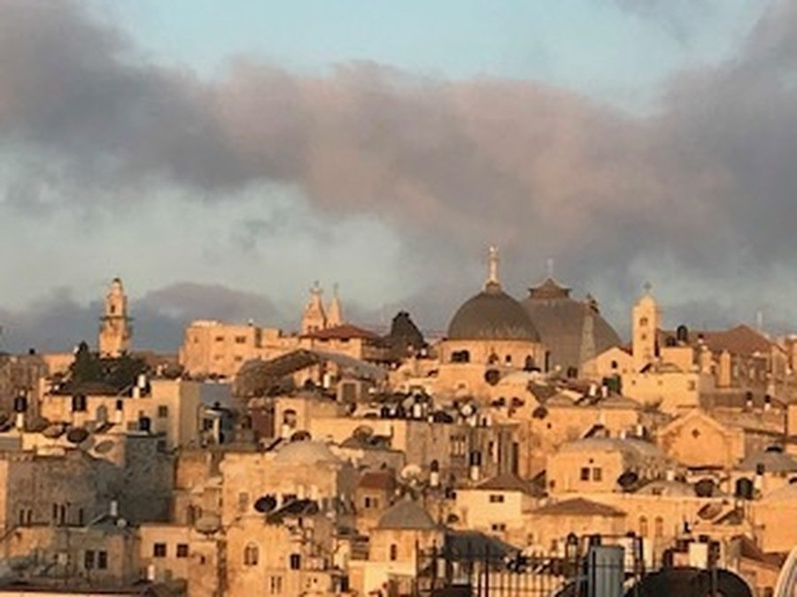 Not fire but a cloud formation at dawn over 'Jerusalem the Golden'.