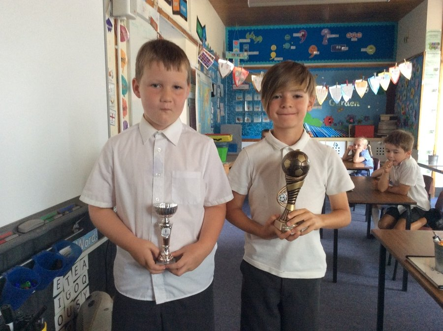 Two football sporting stars showing the class their trophies! Well done!