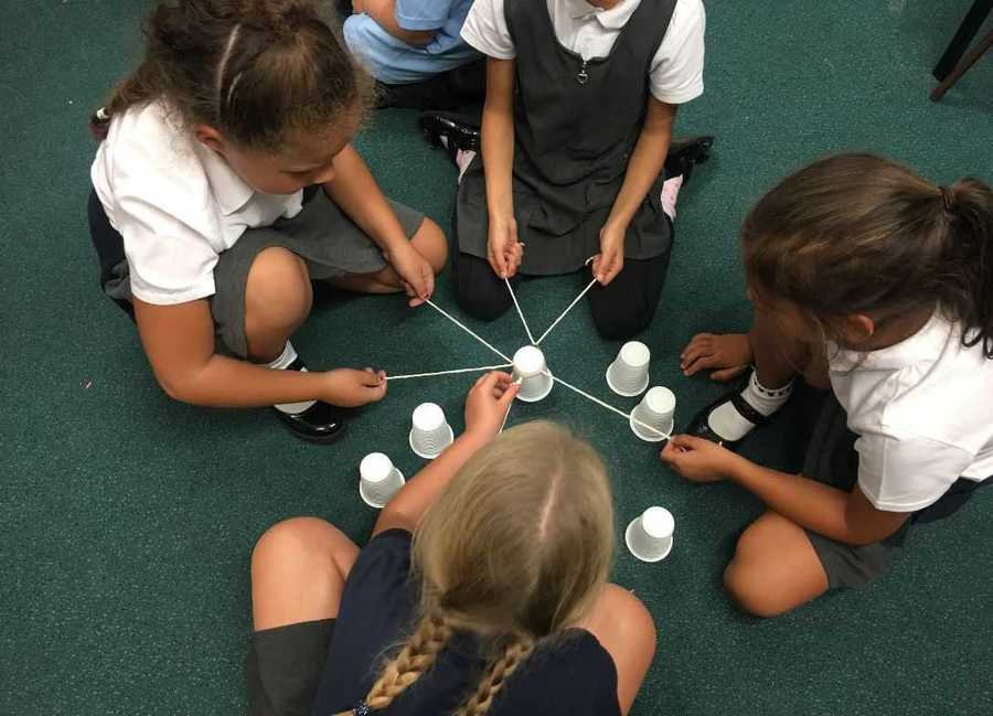 Year 4 displayed their great team work skills whilst trying to making a pyramid of cups using only string and an elastic band.