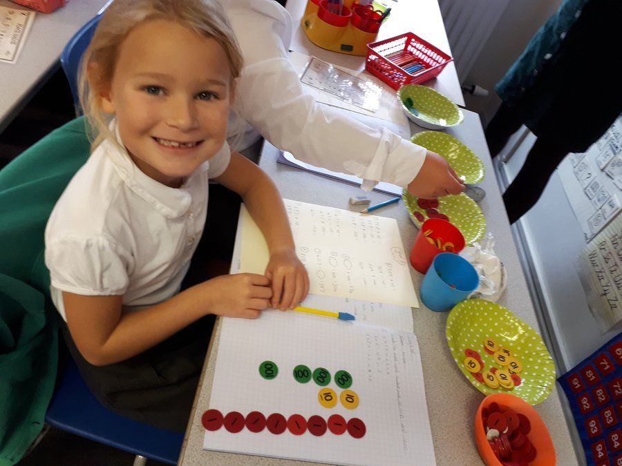 We have been using place value counters in maths.