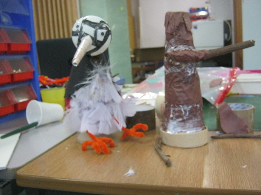 Creating characters with found and recycled materials.