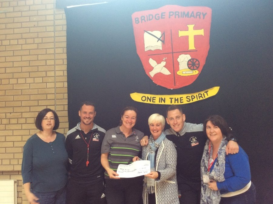 Our Parents' group make a very kind donation to Mrs Whan PE co-ordinator