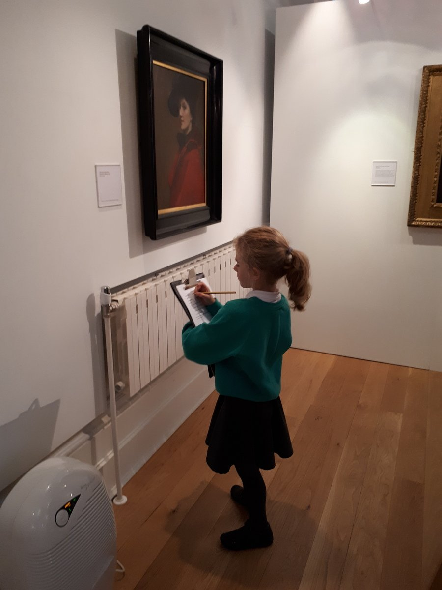Connie deciding if she likes the artwork.