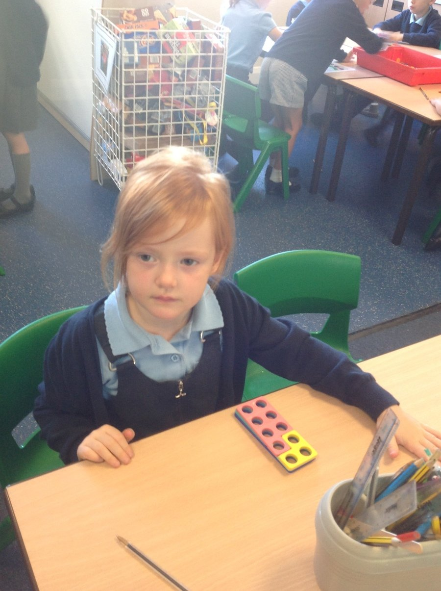 Using Numicon to explore number bonds.