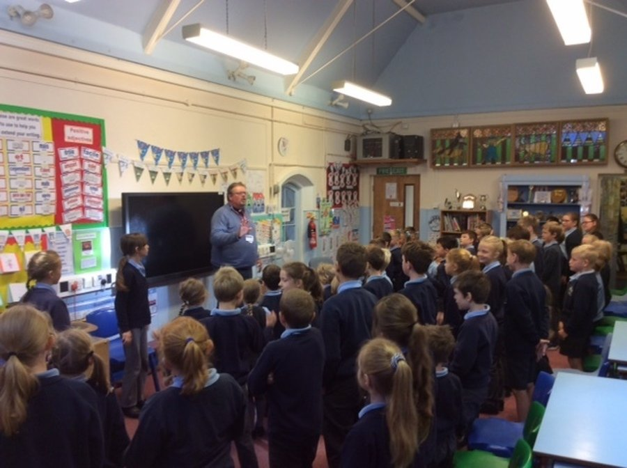 Rev. Jackson Crompton-Battersby comes in to take assembly each week.