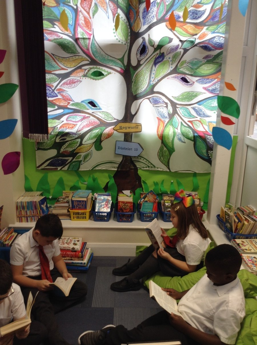 Enjoying our new books in our reading area