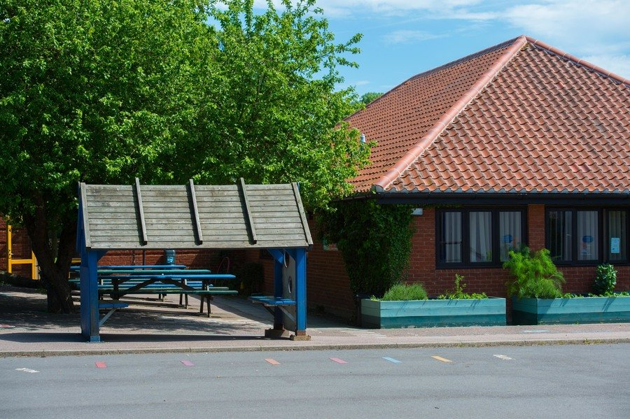 Our playground and modern school building built in the 1980s