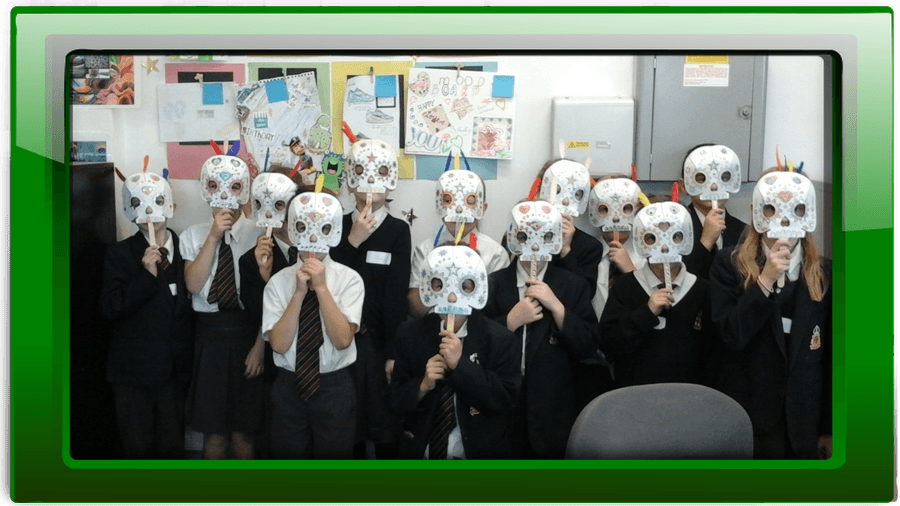 Wearing our scary skull masks made in a DT session at Beccles Free School