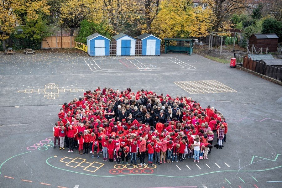 The children and staff made themselves into a human poppy for our Remembrance of 100 years of the end of WW1 and the lives lost so we could live ours.  Lest we forget.