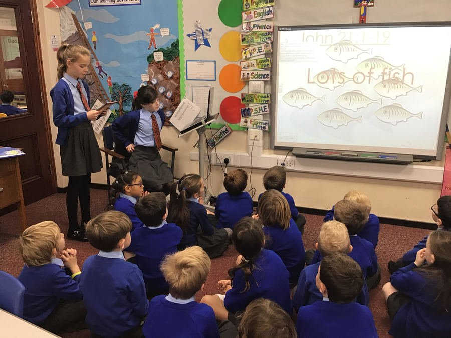 Y2 children enjoying Collective Worship with Y6. November 2018