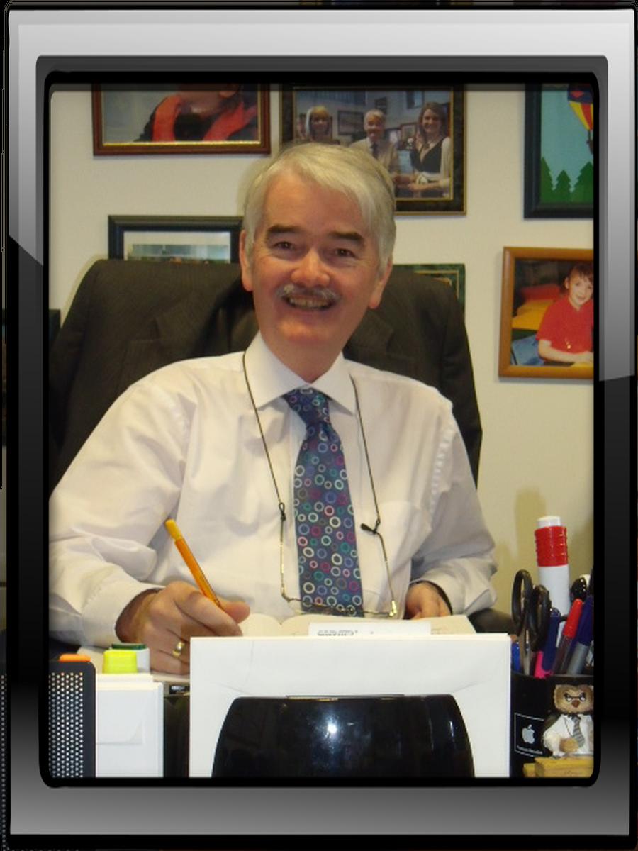 Principal. Dr. Peter Cunningham M.B.E.