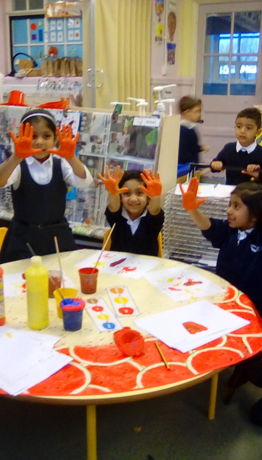 Creating autumn's colours by exploring colour mixing.