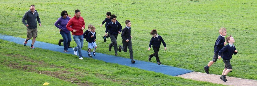 Parents and Pupils running a Daily Mile