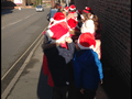 Class 3 and the choir walked to Swadlincote to sing Christmas songs on stage