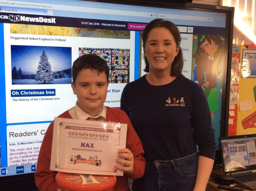 Max received his certificate and prize from Amelia from C2K Newsdesk