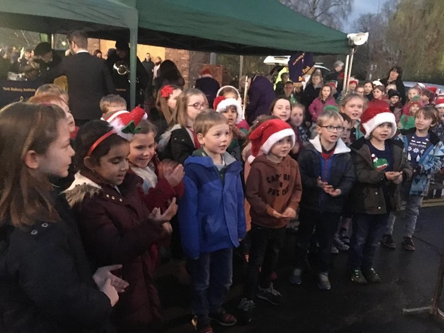 Here we are singing in the village square, before Father Christmas switched on the lights.