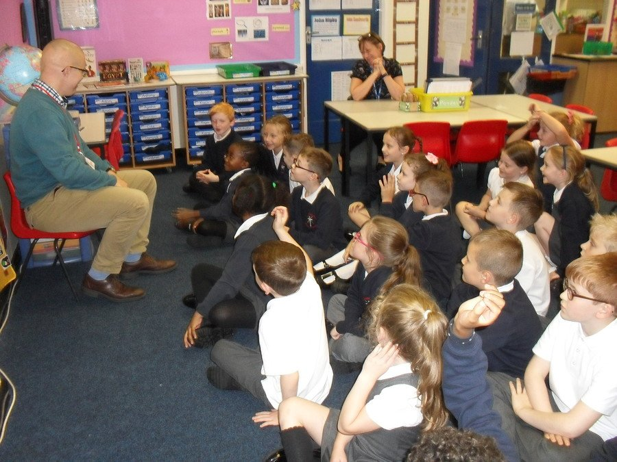 The KS2 classes had a visit from Theo. He told us all about his training to become a priest.