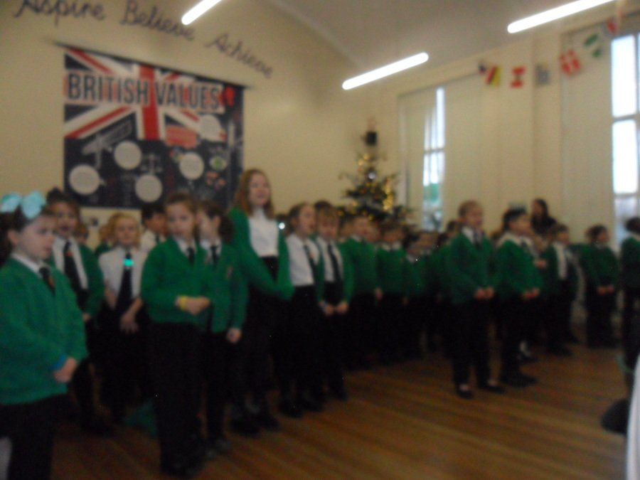 We sung songs around the christmas tree for our parents!