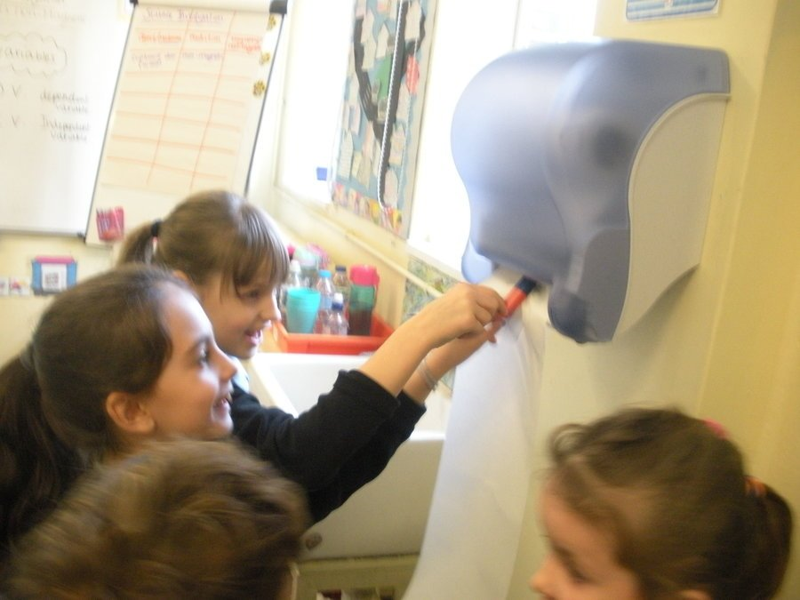 We found out the outside of the tissue dispenser was non-magnetic and the mechanism inside was magnetic!