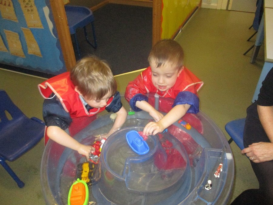 Jack, Lucas, and Oscar explored floating boats in the water tray