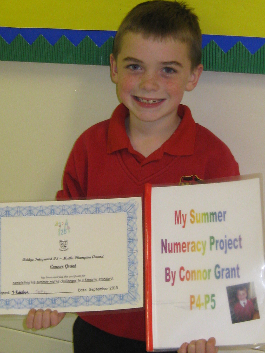 Conor Grant wins a special prize and certificate for completing the Maths summer challenge.  He found numbers in a variety of amazing places.  Well done Conor!