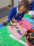 Stella creating art in her scrap book