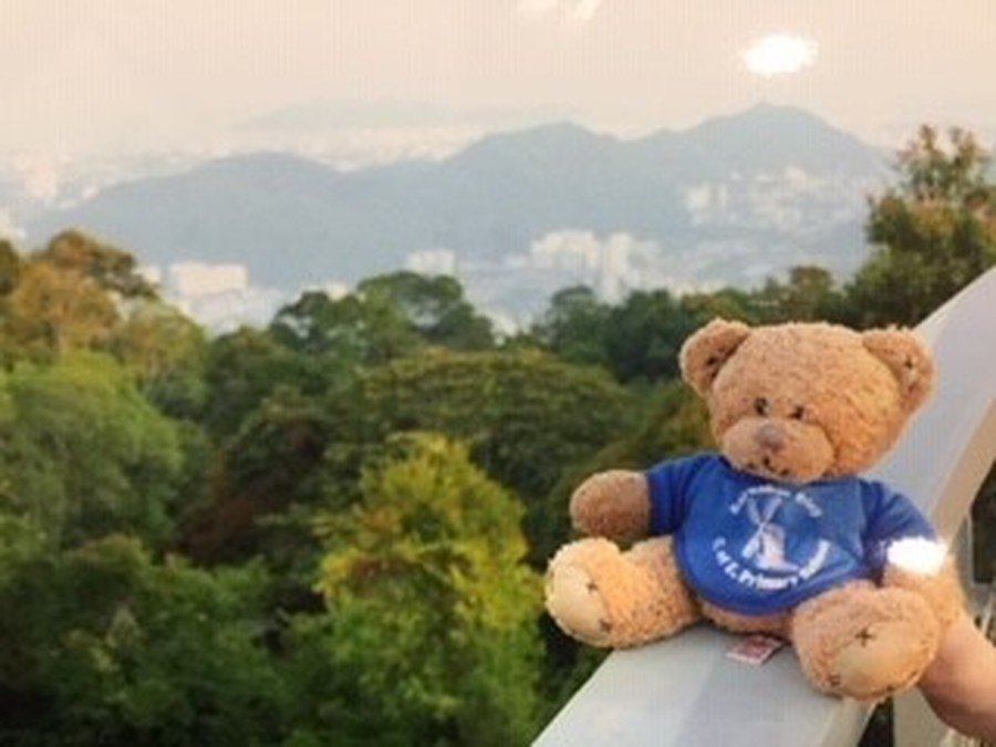 Enjoying the view from top of the Sky Walk at Penang Hill in George Town, Penang, Malaysia.