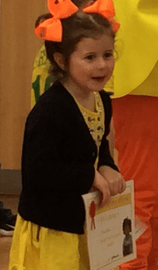 Phoebe getting her certificate at Celebration assembly on Chick day!