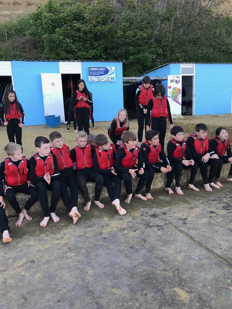 Year 6 are waiting to paddle-board