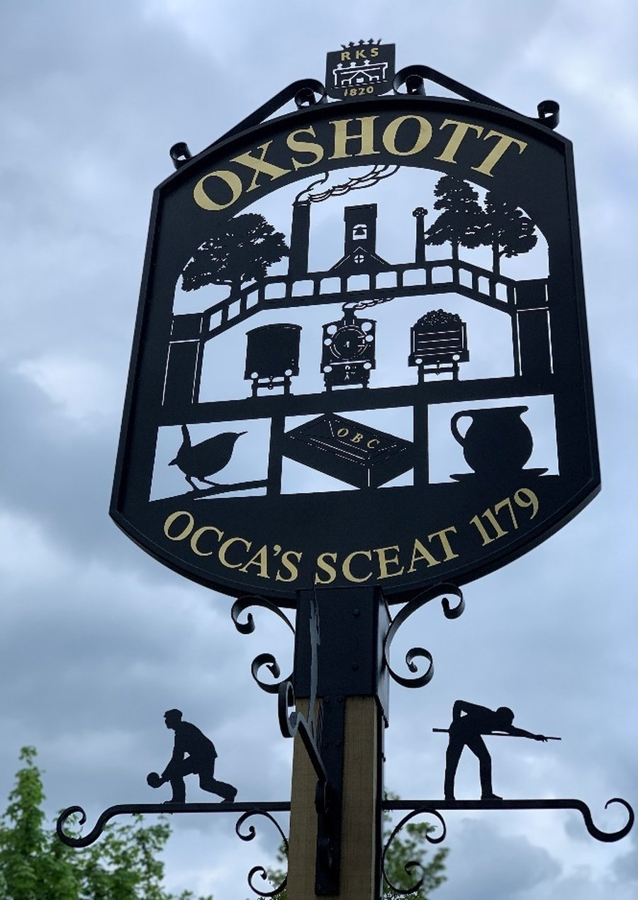 The Oxshott village sign featuring Royal Kent School, May 2019