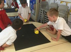 Yr 2 programming beebots to find the fruit to eat .jpg