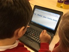 Yr 2 typing caption putting capitals in and commas between names 3.jpg
