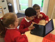 Yr 2 typing caption putting capitals in and commas between names.jpg