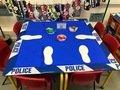Police themed Maths area2D shape shoe print challenge