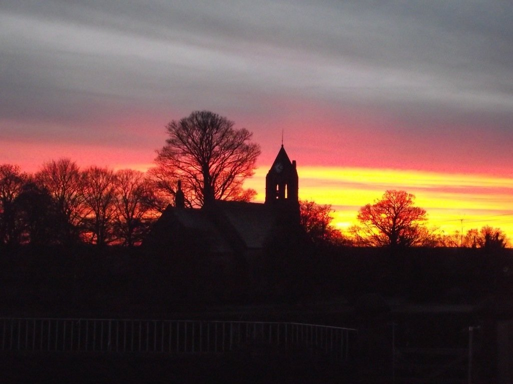 Church at sunset seen from school