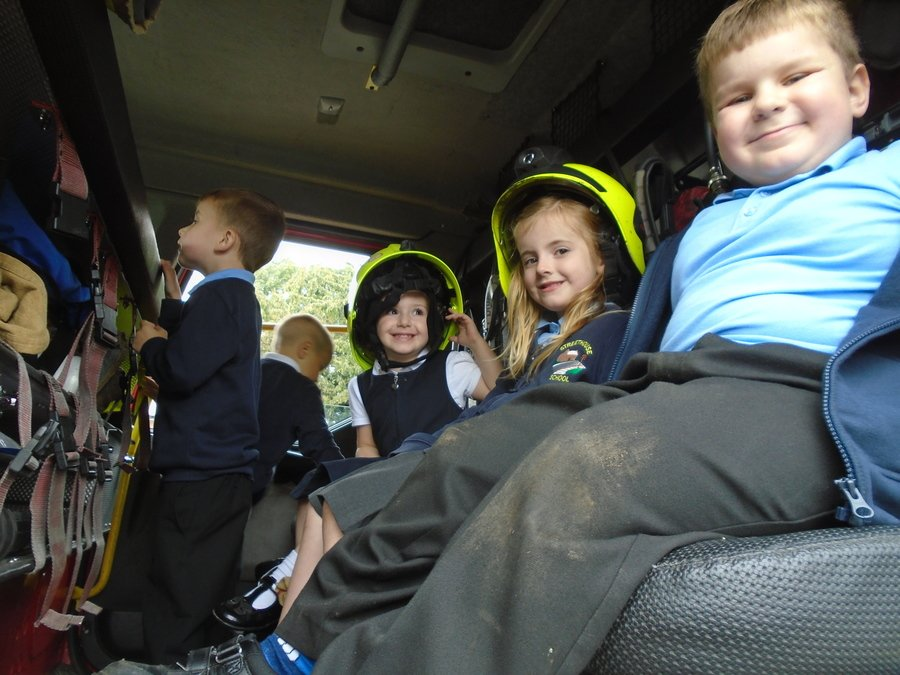 The children enjoyed sitting inside the fire engine.