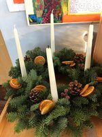 We lit candles in assembly to mark Advent