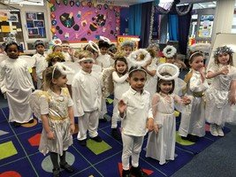 Reception as angels practicing for the Nativity