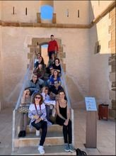 Lorca adults on stairs of castle.JPG
