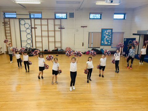 Afterschool cheerleading club for all in the perfect V!