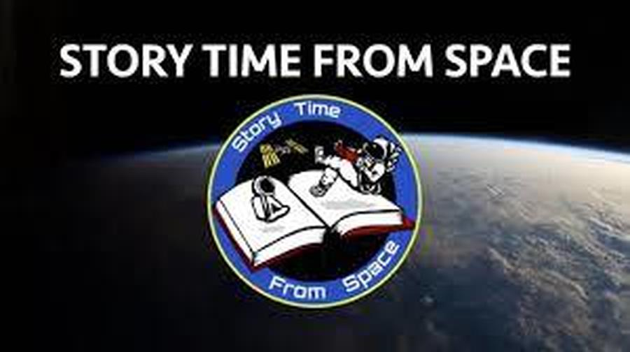 Astronauts reading books in space