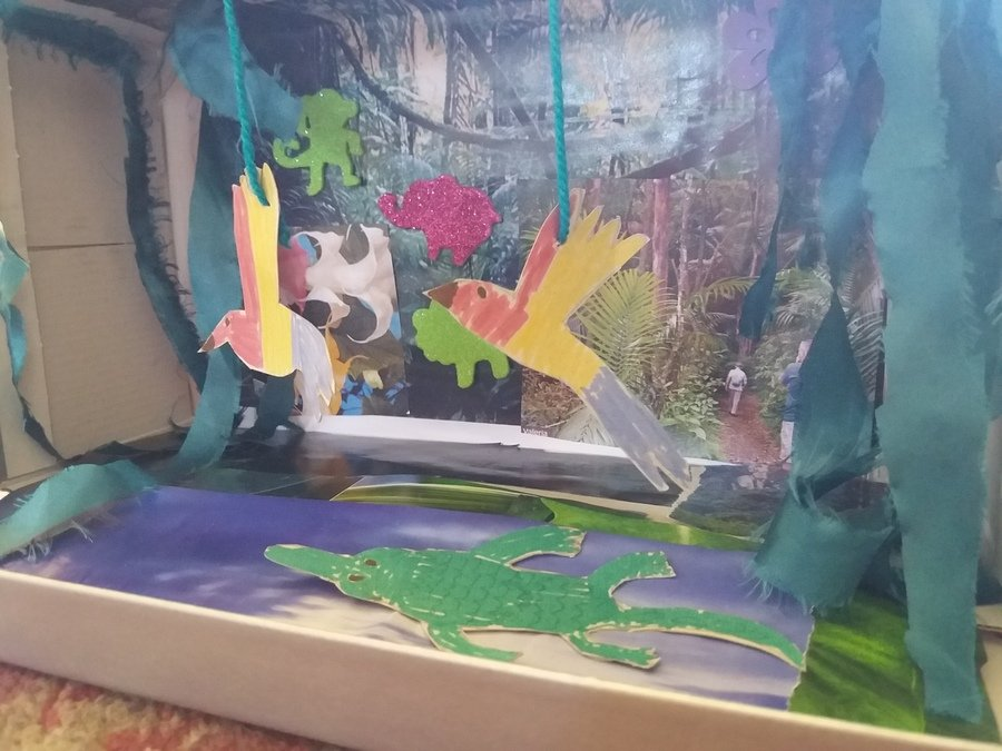 This is Billy's Rainforest habitat box. It has flying parrots and there is a crocodile in the river.