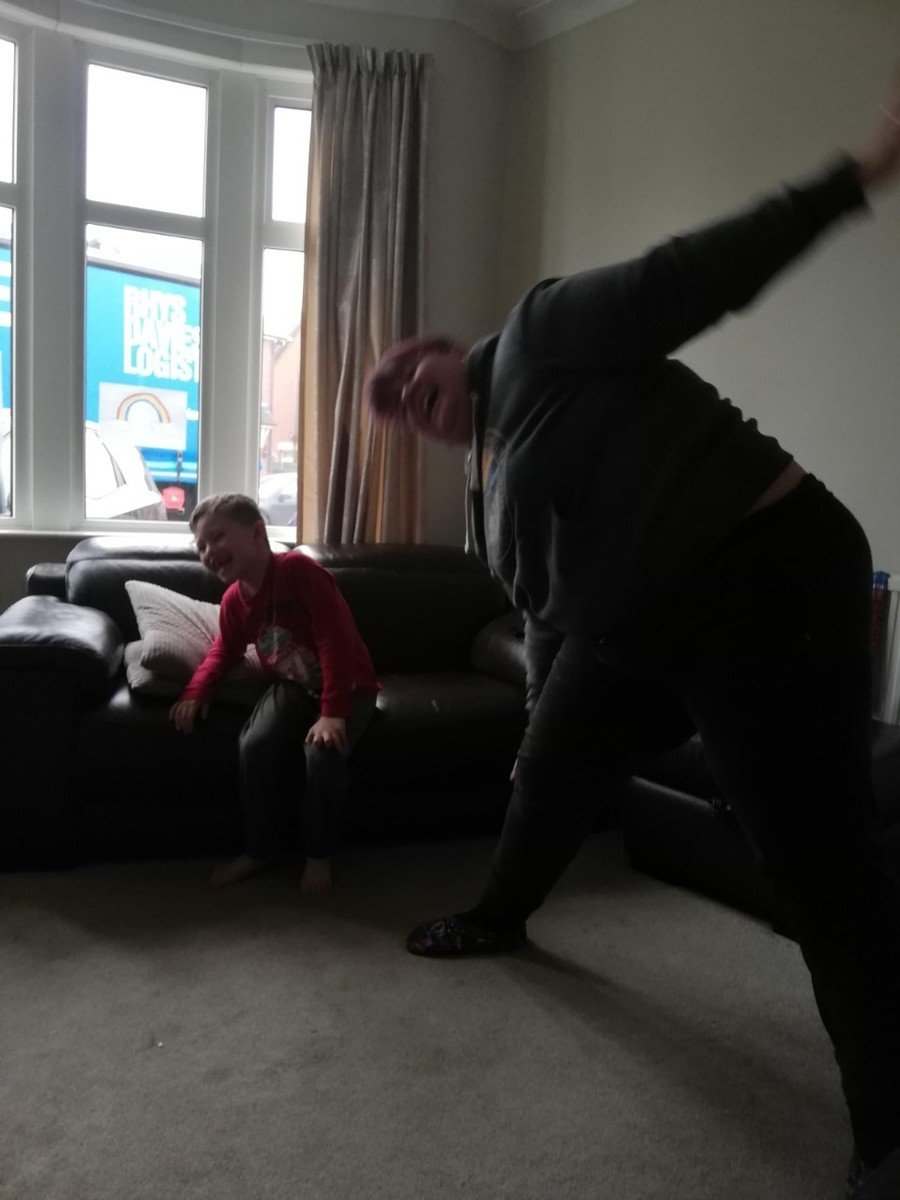 Thomas (Y2) and his mum doing some yoga