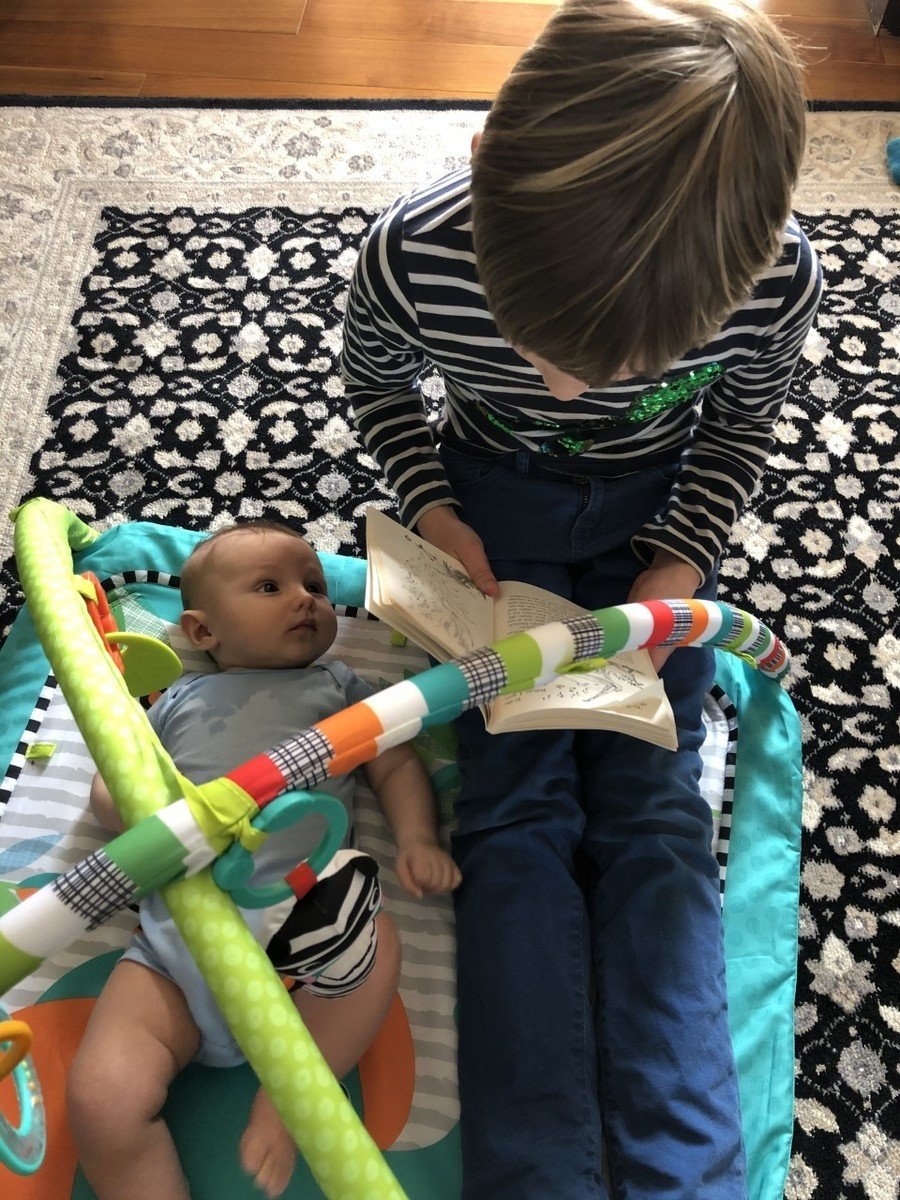 Sarunas reading to his new baby brother!