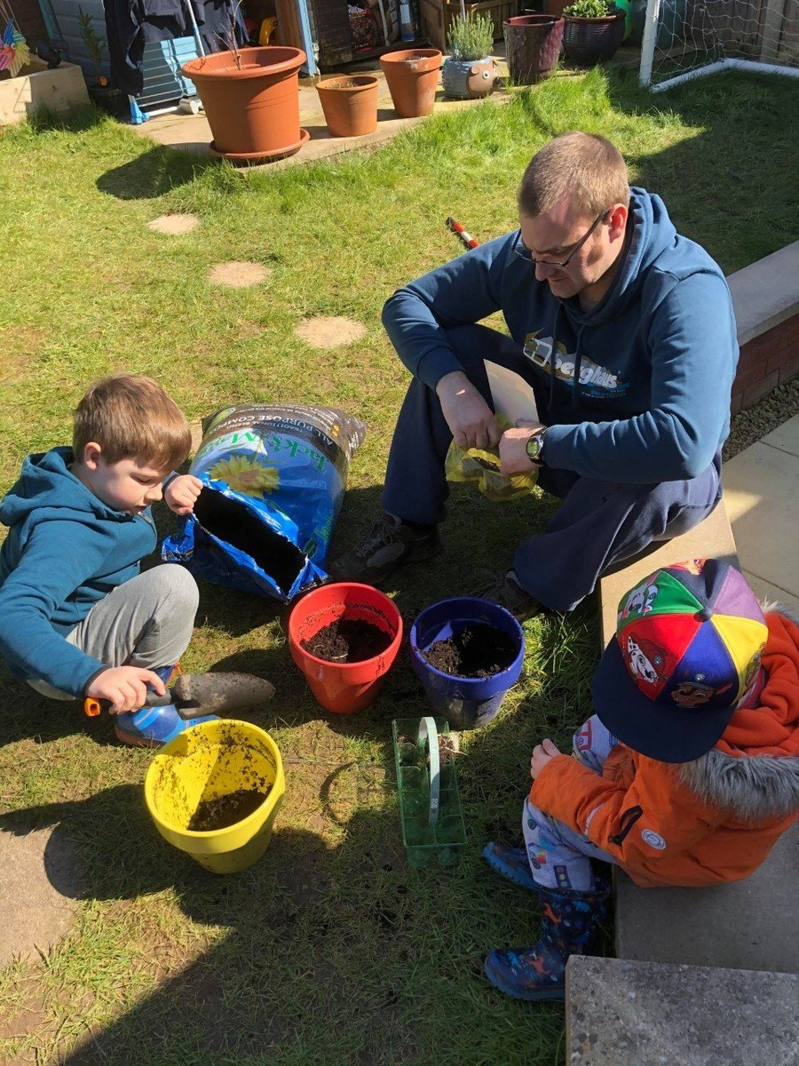 William Y2 and his dad doing some planting