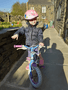 Faith is learning how to ride her bike well done!
