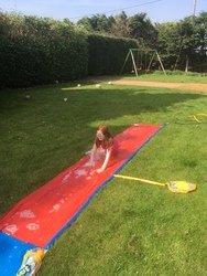 Chelsea having fun on the water slide!