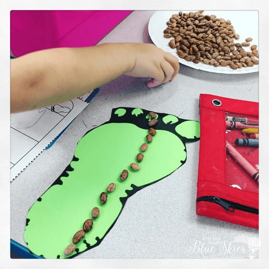Draw around your foot and cut it out. Can you measure it using different objects in your house? Can you find someone in your house who has a bigger foot? What do you think the giant's foot would look like?