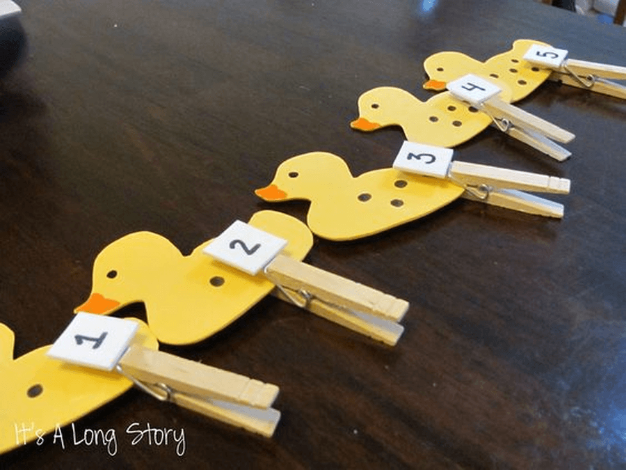 Draw dots on your Five Little Ducks and then add the right number of clothes pegs to match the numbers or write the number on the peg and match them up.